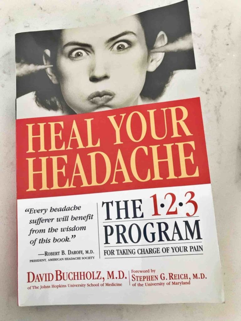 The Heal Your Headache book on a white background