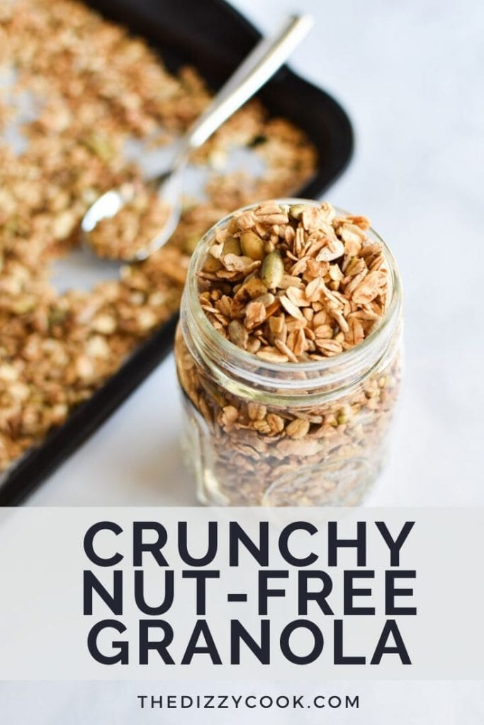 Nut free granola in a jar next to a sheet pan