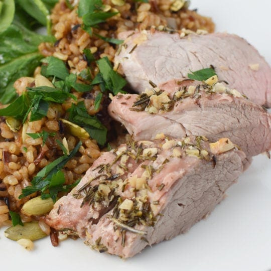 Roasted pork loin with winter rice pilaf and a simple salad