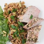 Pork loin with rice pilaf and salad
