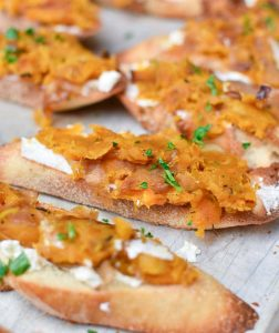 Made with fresh goat cheese or ricotta, these butternut squash toasts have caramelized shallots and a little mint for a sweet and savory appetizer. Perfect for the holidays! #appetizers #holiday #christmas #butternutsquash