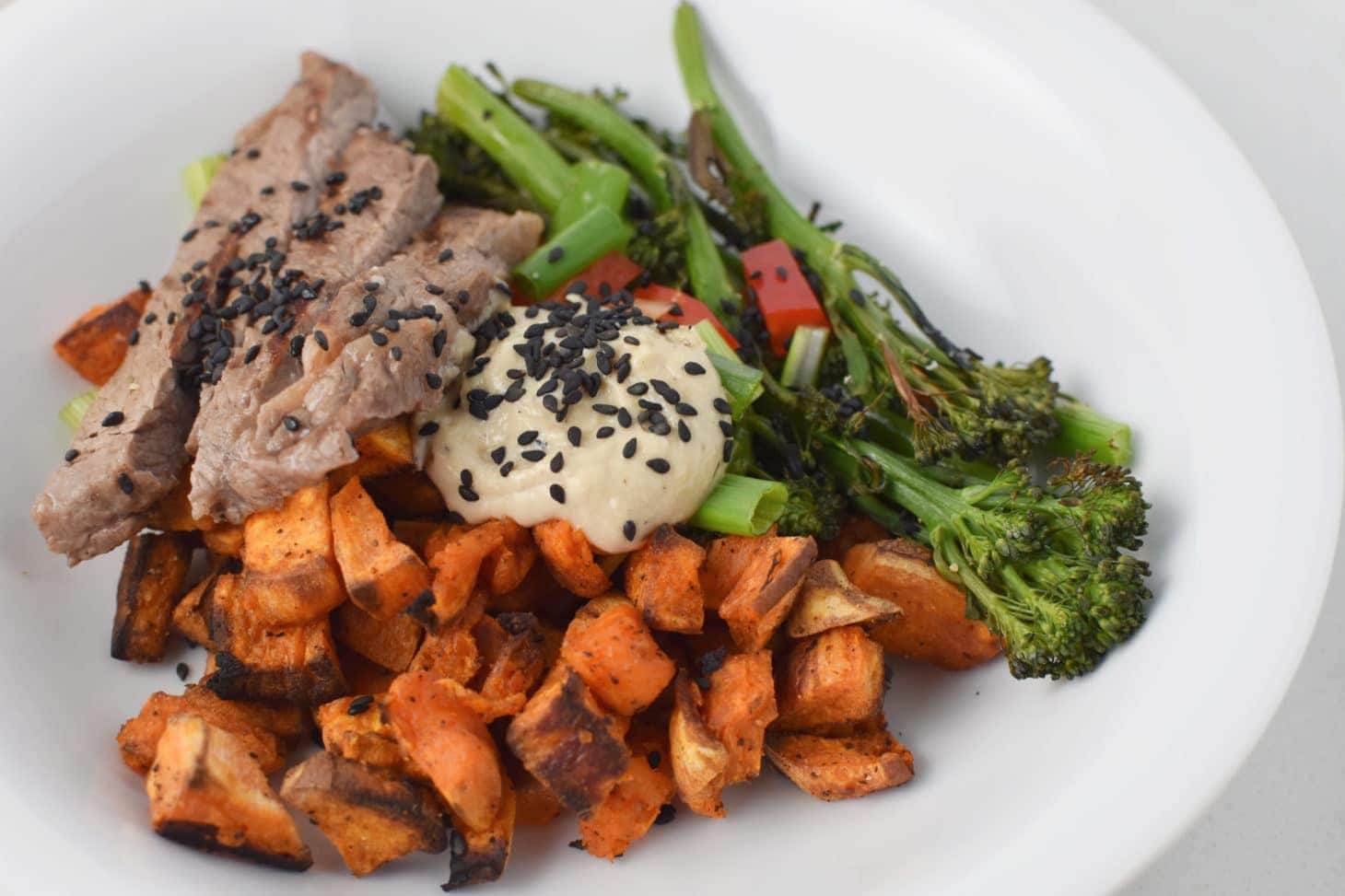 Paleo steak and tahini bowl with sweet potatoes and broccolini