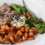 Paleo steak and tahini bowl with sweet potatoes and broccolini