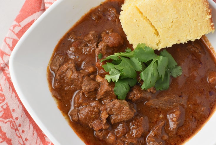 A bowl of Texas chili with gluten-free cornbread
