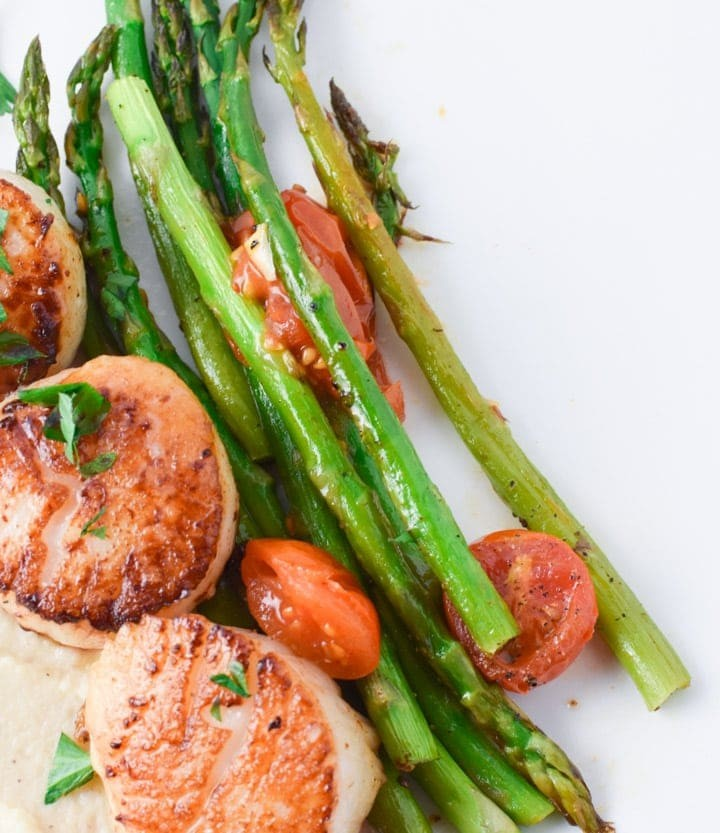Seared scallops with chive oil are perfect for any date night or Valentine's day dinner. Gluten free and delicious, this recipe is great with mashed cauliflower and roasted asparagus #scallops #datenight #easyrecipe