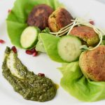 Falafel with cucumber, pomegranate, and zhoug sauce