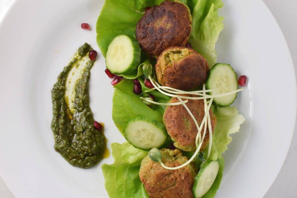 Falafels with cucumber, pomegranate, and zhoug sauce