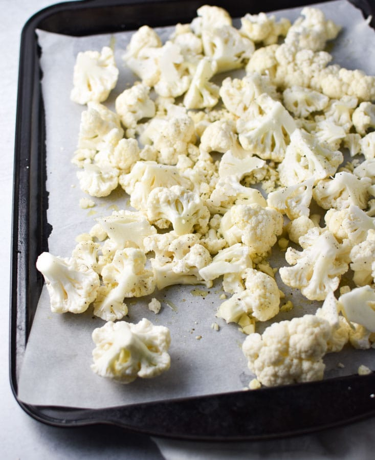 cauliflower florets on a sheet pan