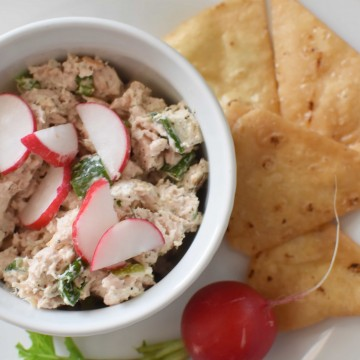 Tuna salad topped with radish next to pita chips