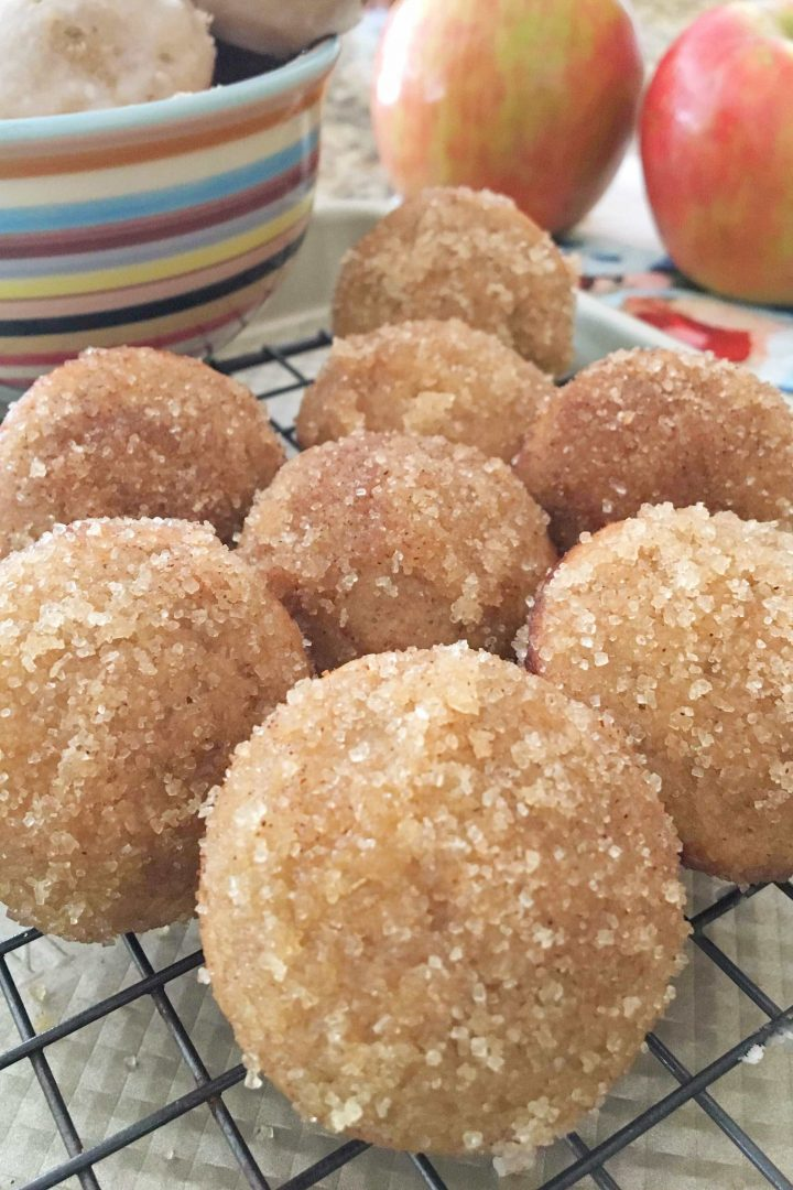 gluten free donut holes on a black cooling rack
