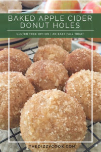 apple cider donut holes on a rack with apples in the background