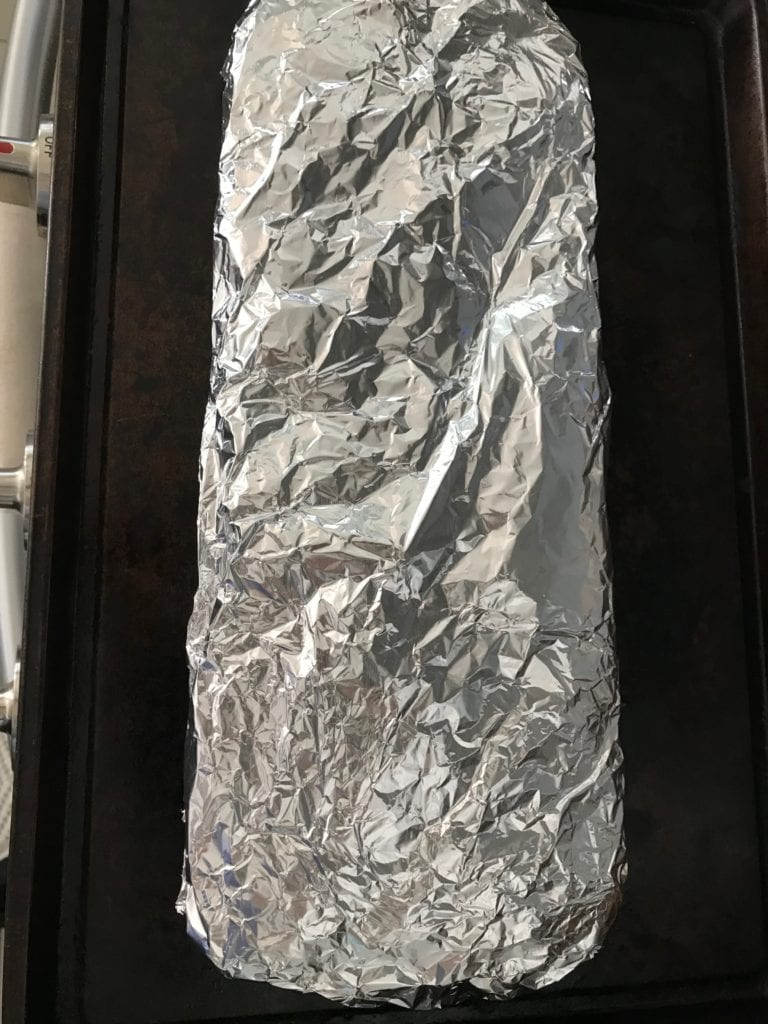A rack of ribs wrapped in foil