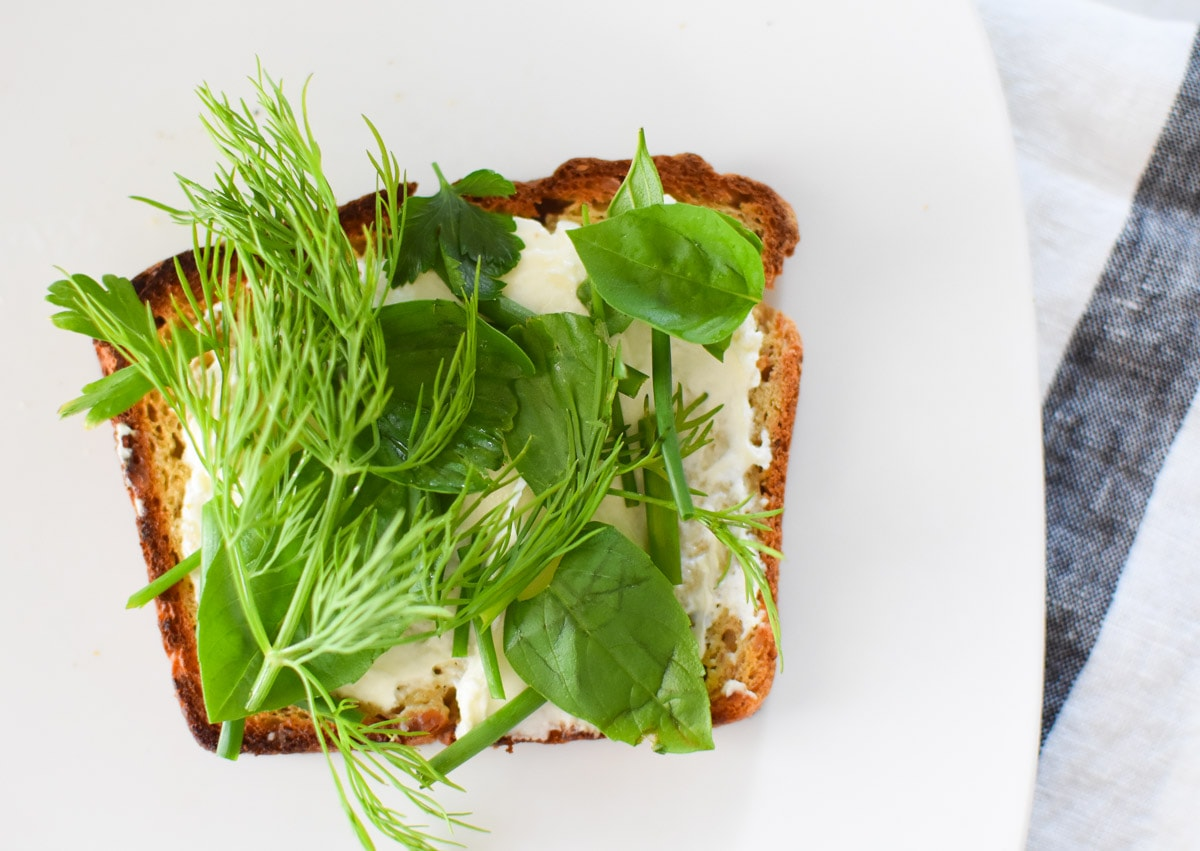 French toasts with cream cheese and fresh herbs