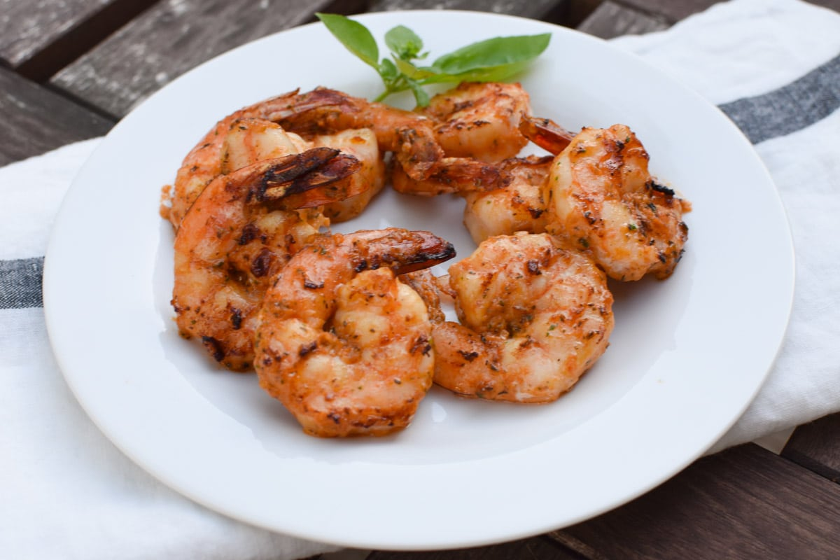 Grilled Italian Shrimp that's a super easy weeknight meal or for having company over. This is migraine diet heal your headache safe as well as gluten free and paleo. #grilledshrimp #shrimprecipes