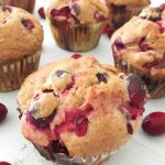 The perfect fall muffin for your Thanksgiving or Christmas breakfast! Light and fluffy, these cranberry pomegranate muffins can be made gluten free. #vegetarian #muffins #fall #cranberry #pomegranate