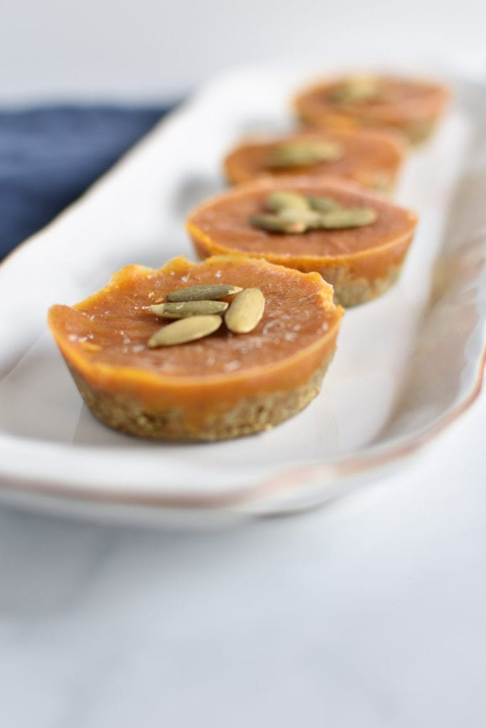 Allergy friendly pumpkin pie bites that are egg free, dairy free, gluten free, and nut free. Perfect for Thanksgiving, these bites are frozen and easy to make. #pumpkinpie #thanksgiving #recipes #paleo #nutfree