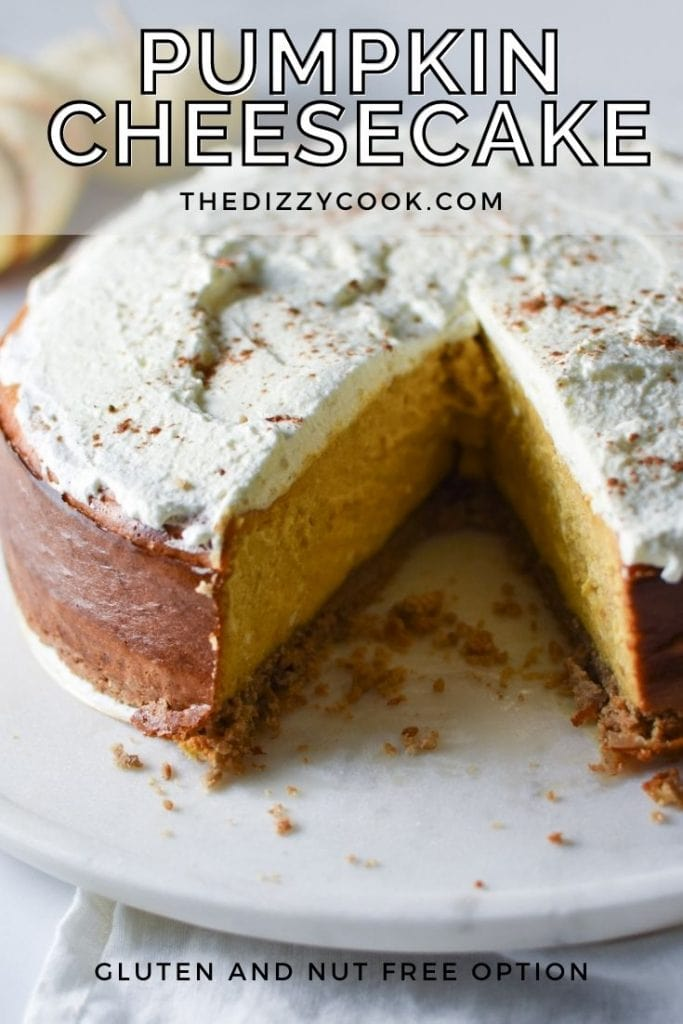 A sliced pumpkin cheesecake with whipped cream