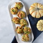 Stuffing balls on a white plate with 2 pumpkins