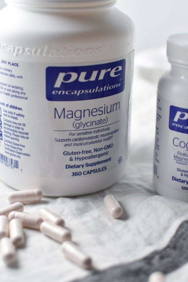 Two bottles of magnesium with supplements on the table