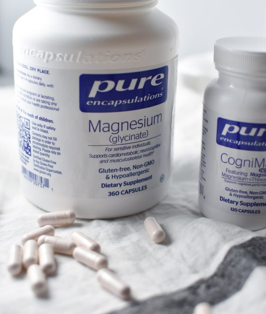 Two bottles of magnesium with pills on the table