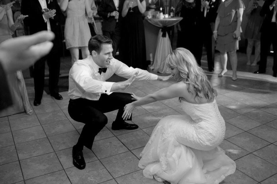A bride and groom dancing at their wedding
