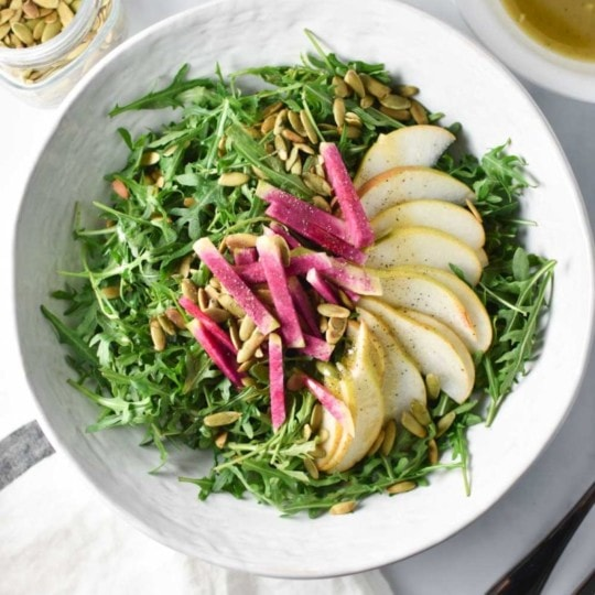Using all vegan ingredients, this nut free salad is delicious enough to stand alone or make an awesome side dish. Radish,, pears, arugula, and a simple maple vinaigrette star. #salad #vegan on The Dizzy Cook #migrainediet #nutfree