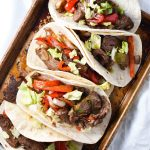 Quick and easy steak fajita recipe, perfect for a Friday night dinner. These flank steak fajitas are marinated in fresh (migraine safe) spices and cherry juice, which gives it the tart flavor without citrus. #fajitas #steak #migrainediet