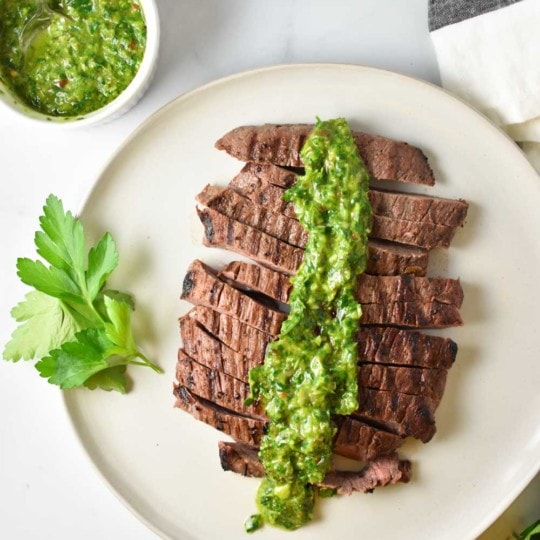 Marinated grilled steak with a flavorful cilantro chimichurri sauce that's good on chicken, seafood...just about anything! #chimichurri #steak #migrainediet