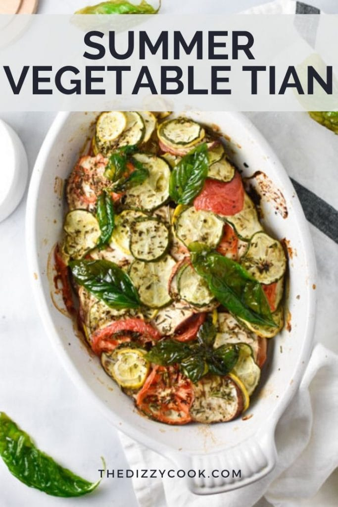 Vegetable tian in a white baking dish