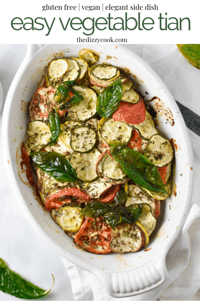 This vegan summer vegetable tian is all the best flavors of roasted zucchini squash, eggplant, tomatoes, and herbs topped with crispy fried basil. It looks complicated, but is a very simple and delicious recipe. #vegetarian #vegan #vegetabletian #squash