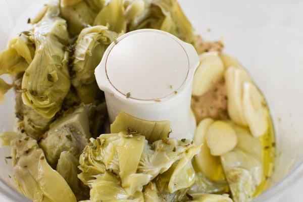 Artichokes and garlic in a food processor