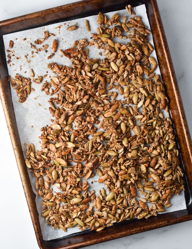 Toasted seed granola on a sheet pan