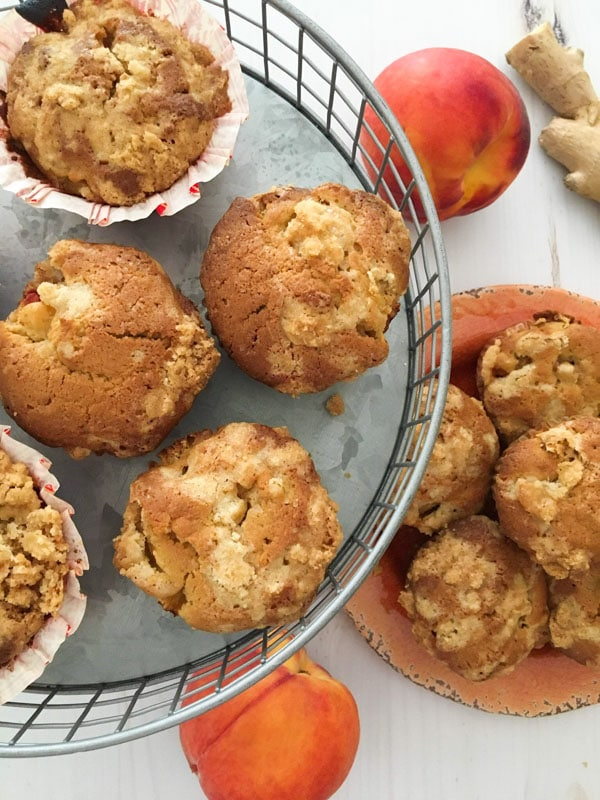 A silver platter of muffins with peaches and ginger