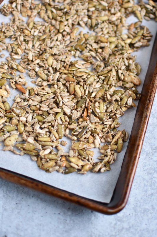 Different types of seeds on a sheet pan before baking