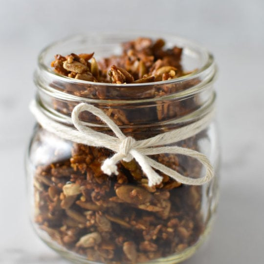 Granola in a mason jar with a twine bow