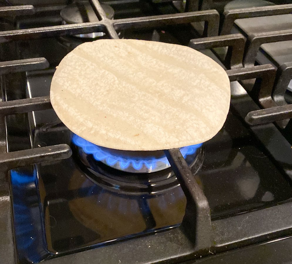 Tortillas cooking on a gas grill
