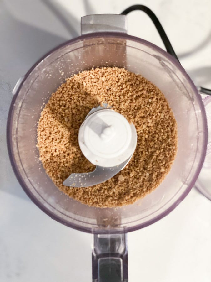 sunflower seeds being ground in a small food processor