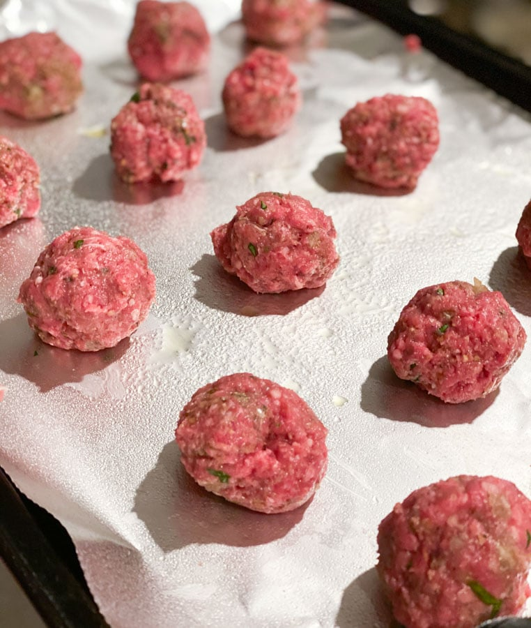 meatballs rolled on a greased pan with tin foil