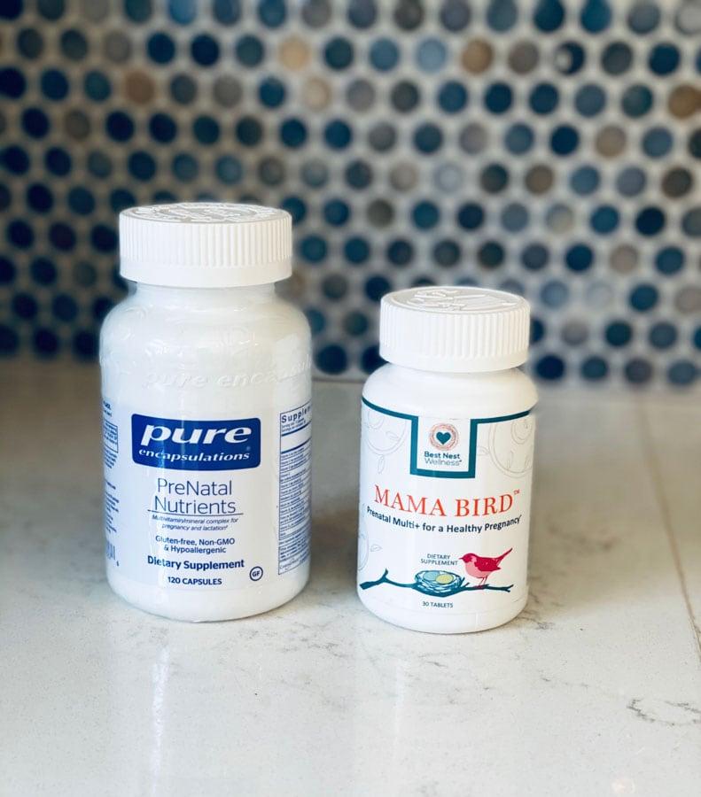 pure encapsulations and mama bird prenatal vitamins on a white counter