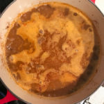 a big pot of texas chili simmering on the stove