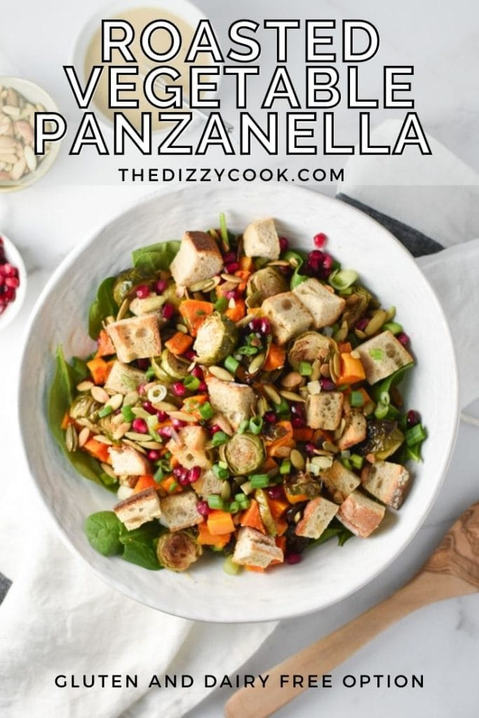 Roasted winter panzanella salad in a white bowl