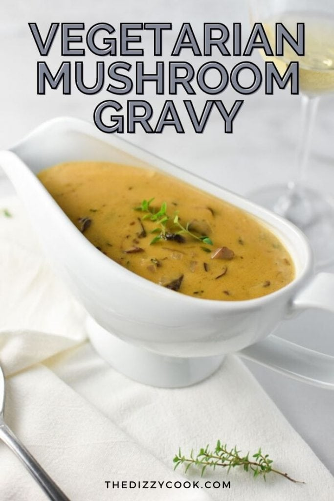 mushroom gravy in a white gravy boat with a napkin and glass of wine