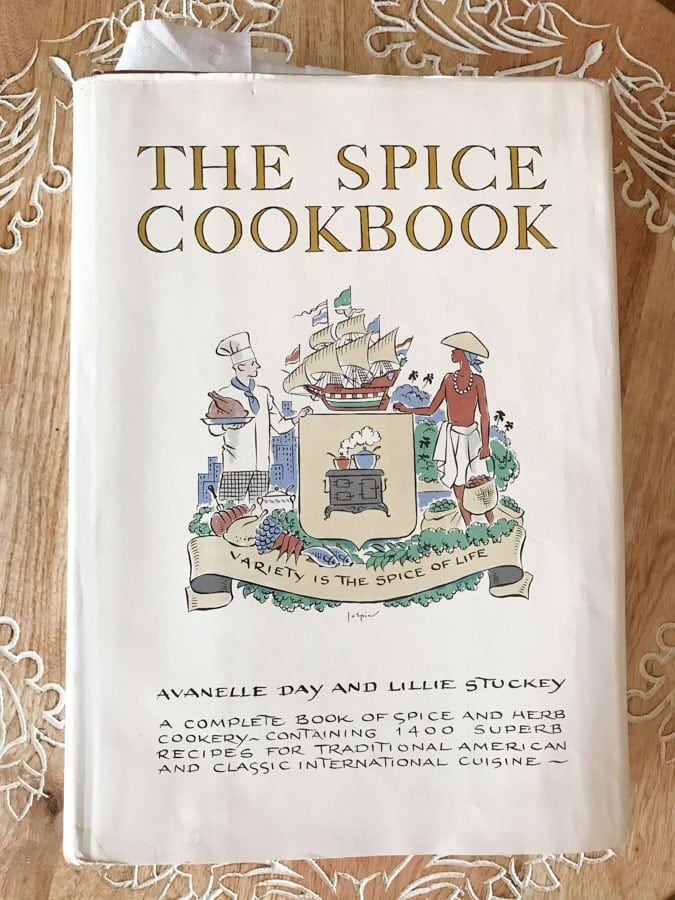 the spice cookbook on a kitchen counter