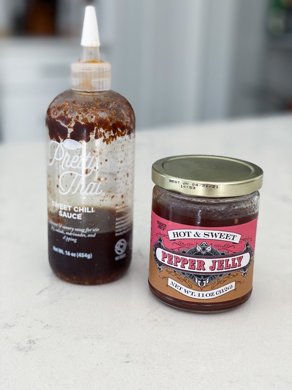 Two kinds of sweet chili sauces on a white counter