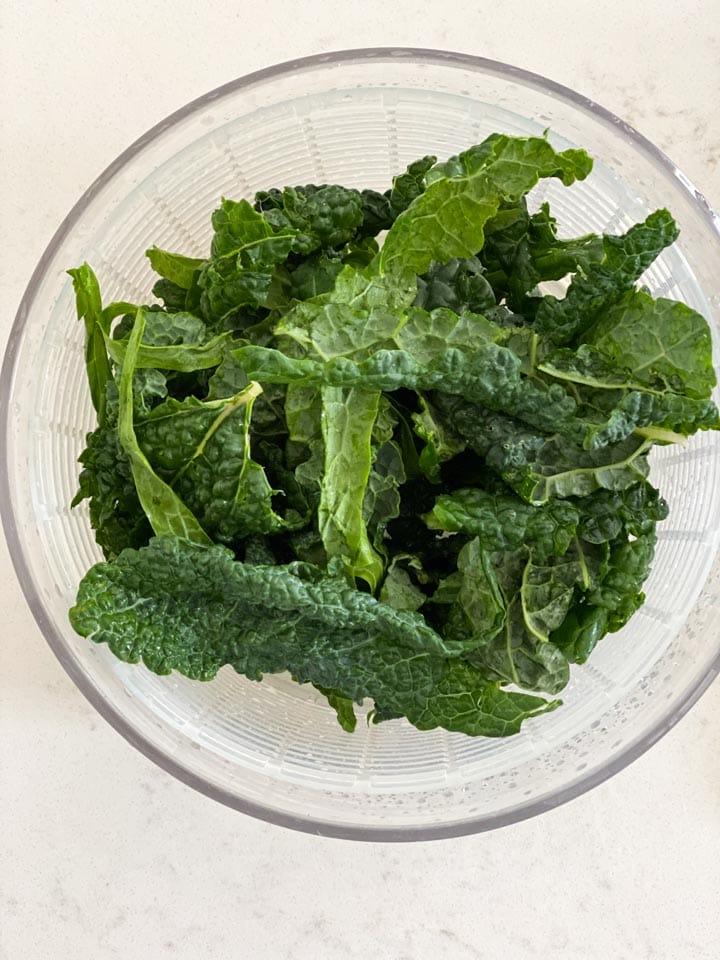 A salad spinner with kale