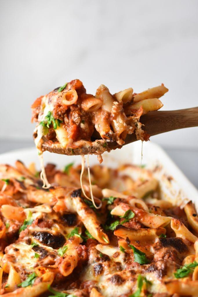 A scoop of cheesy lasagna