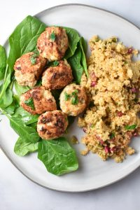 Chicken meatballs on a plate with couscous