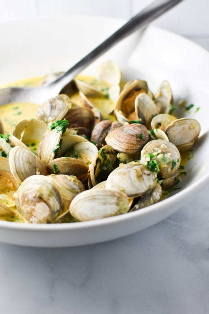 Steamed clams in an an herbed broth sauce