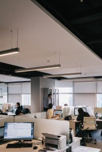 An image of a workplace with cubicles