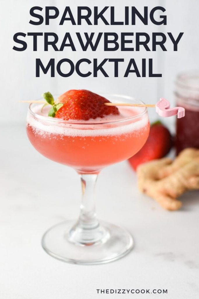 A strawberry cocktail in a coupe glass